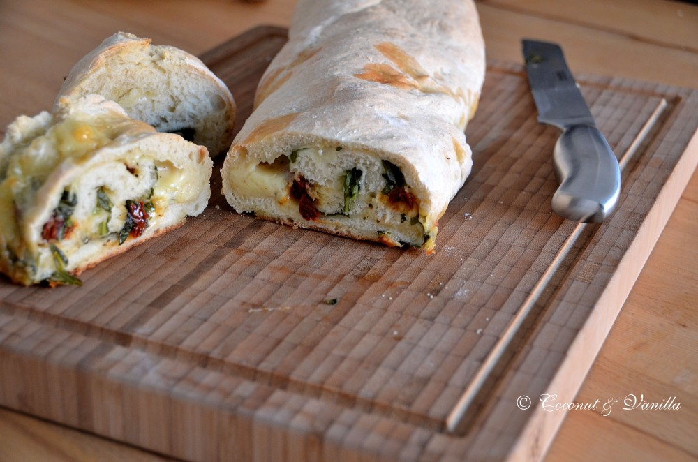 focaccia filled with cheese, arugula and dried tomatoes