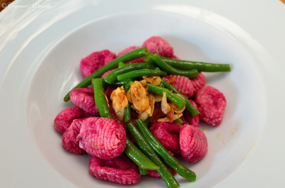 Beetroot Gnocchi with green beans in a twofold brown nut butter