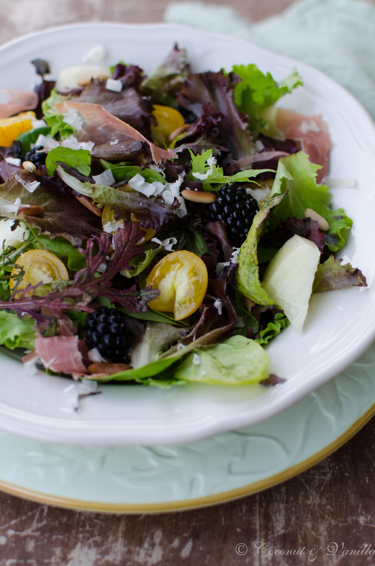 Mesclun salad with blackberries, cantaloupe and prosciutto